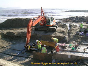 Lyme Regis - diggers working on sea defences